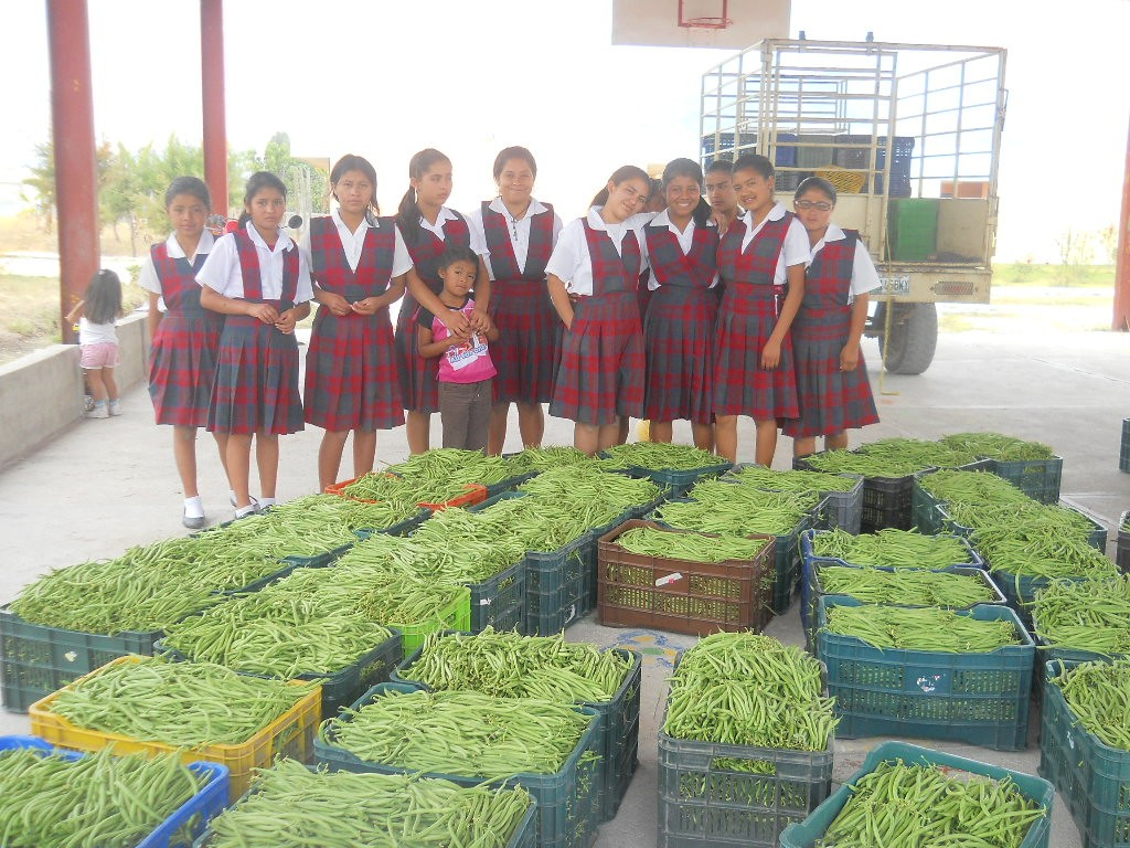 MyM residents with the fruits of their labor